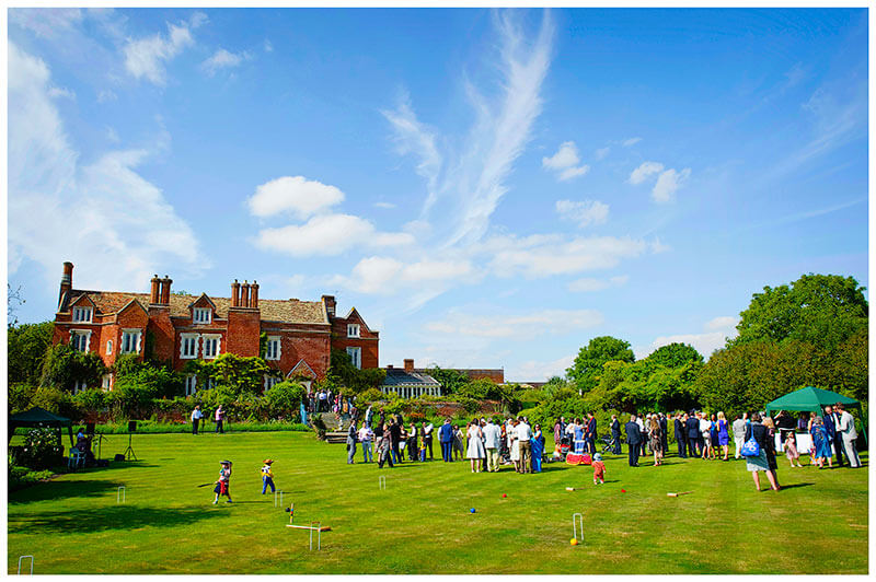 wedding guests on the lawn of Childerley Hall