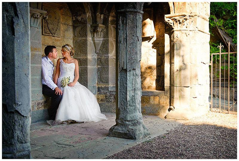 bride sits on grooms lap in an italian castle
