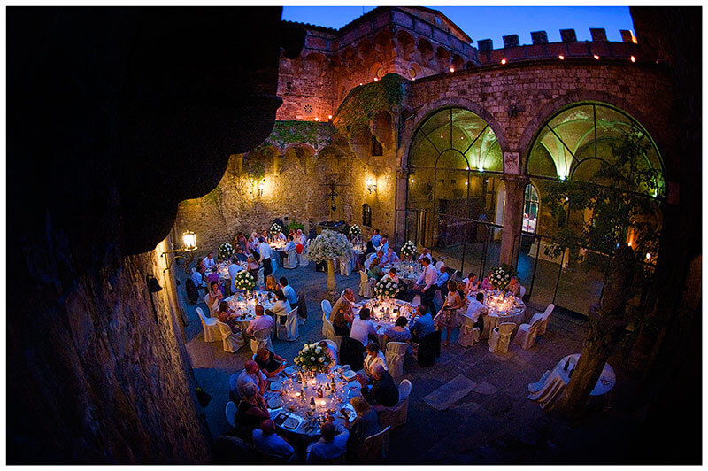 wedding dinner in the central courtyard at castle in italy