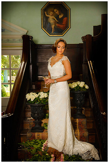 bride on stairs surrounded by flowers