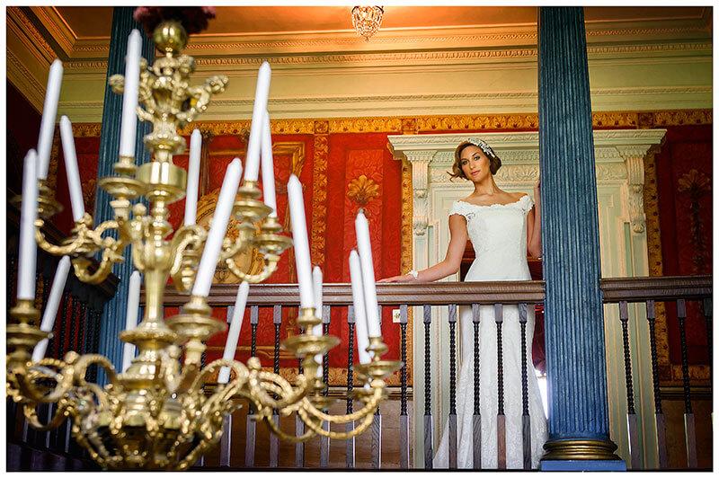 bride sttod on landing next to blue pillar