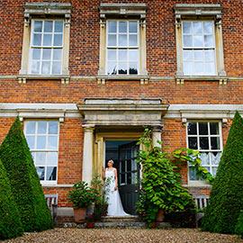 wedding venue island hall entrance with bride