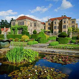 fanhams hall viewed across gardens fountain