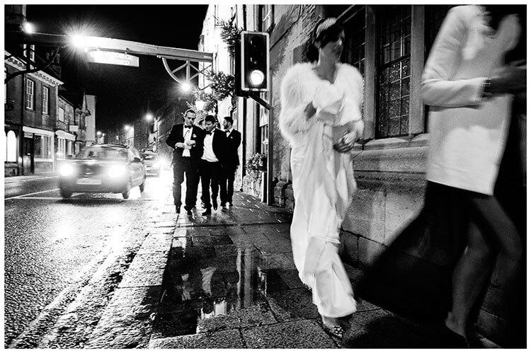 wedding guests walking stamford streets at night