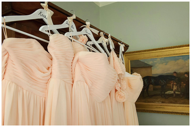 brides maids dresses hanging on wardrobe
