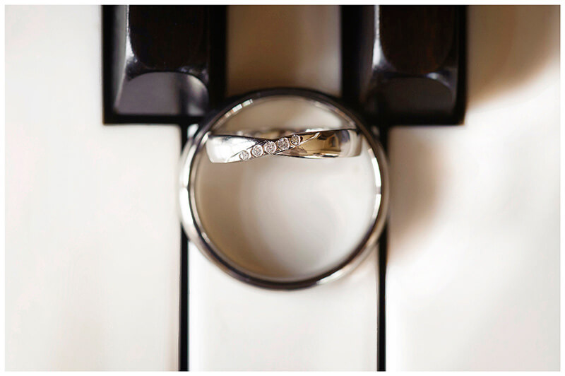 wedding bands on piano keys