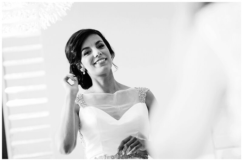 smiling bride reflected in mirror