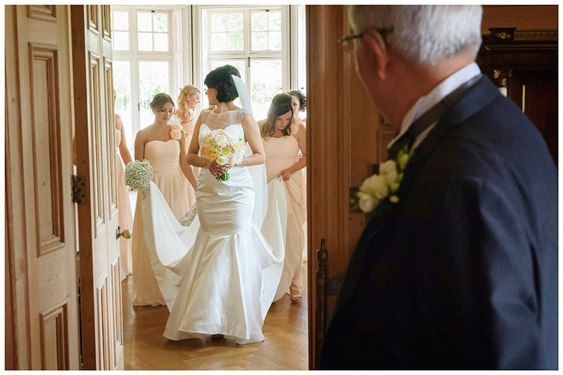 bride getting ready to leave watched by father