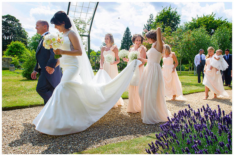 bridal party walking past lavender in chippenham park gardens