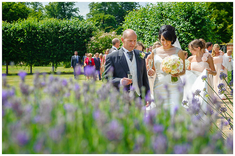 smiling bride and groom champagne lavender chippenham park gardens