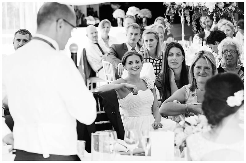 guests during grooms speech in marquee