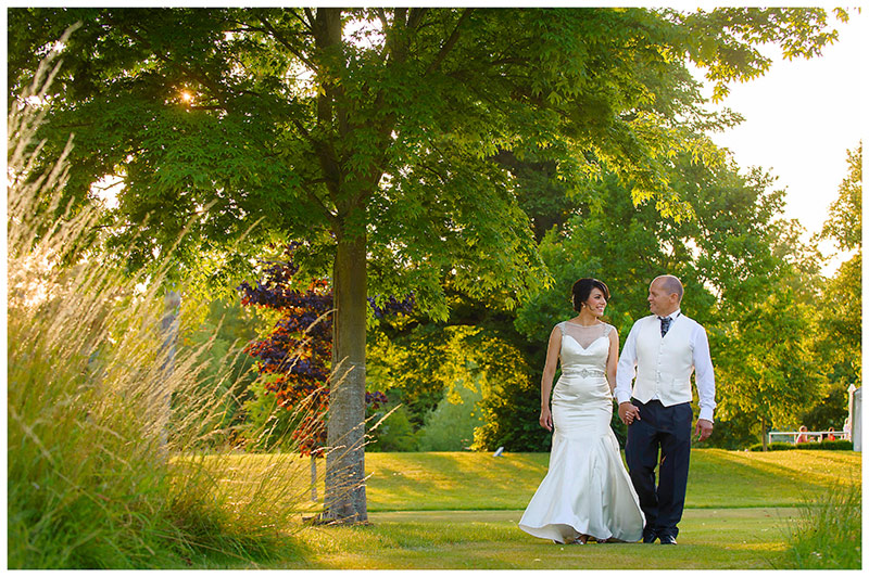 late evening romantic bride and groom go for a walk around chippenham park gardens