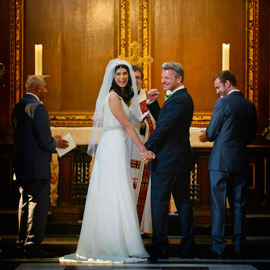 christs college wedding photographer groom celebrates punches air