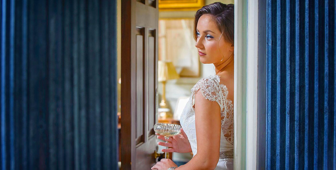 creative wedding photographer cambridge uk europe bride champagne glass blue pillars