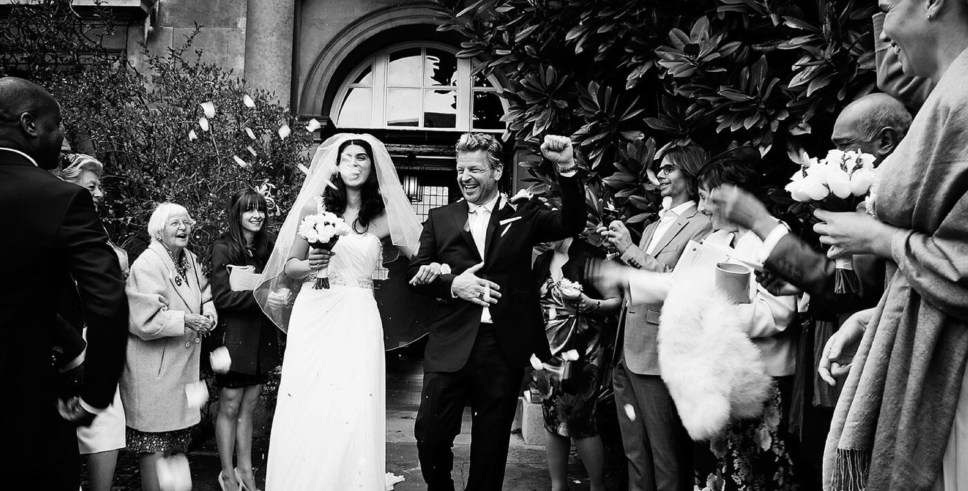 creative documentary wedding photographer cambridge uk europe bride groom confetti