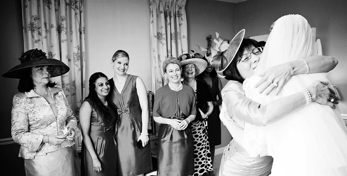 creative documentary wedding photographer cambridge uk europe destination bride hugs