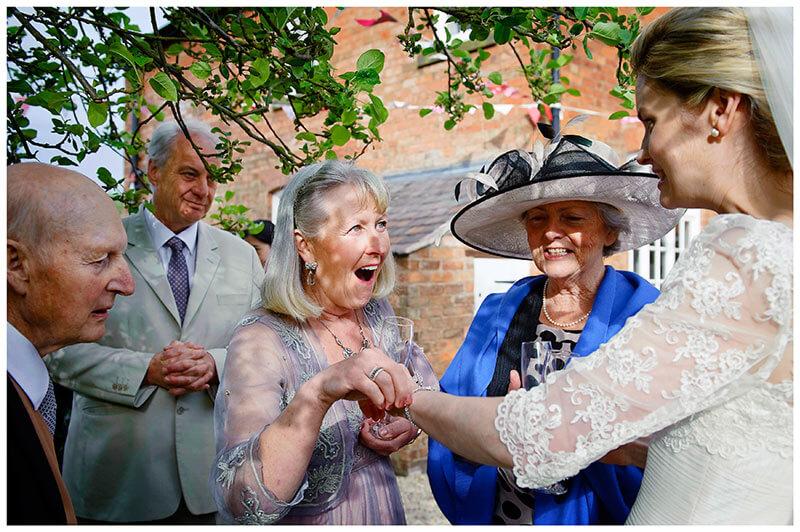 documentary wedding photographer look of delight