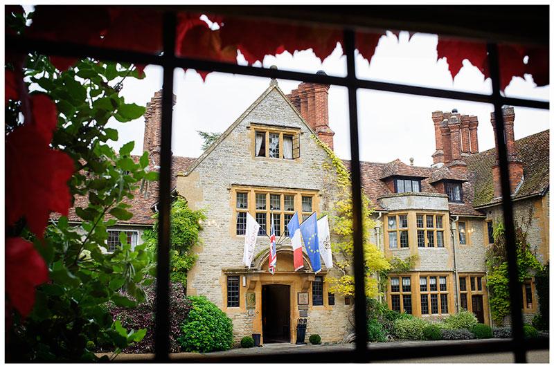le manoir aux quat'saisons Oxfordshire wedding venue through window