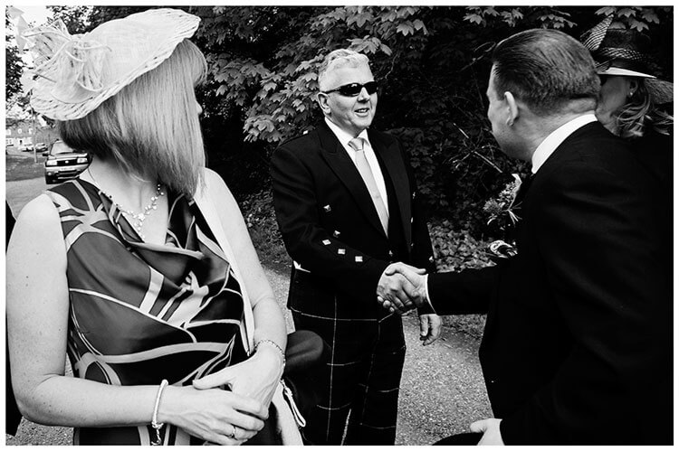 Hartford Church Wedding guest shakes grooms hand