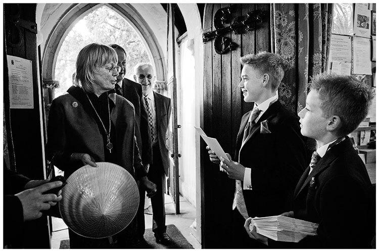 Hartford Church Wedding young ushers greet guests at entrance to church