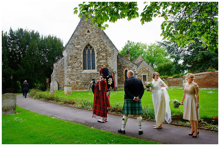 Hartford Church Wedding bride bridesmaid looking back as Scottish piper leads way to church