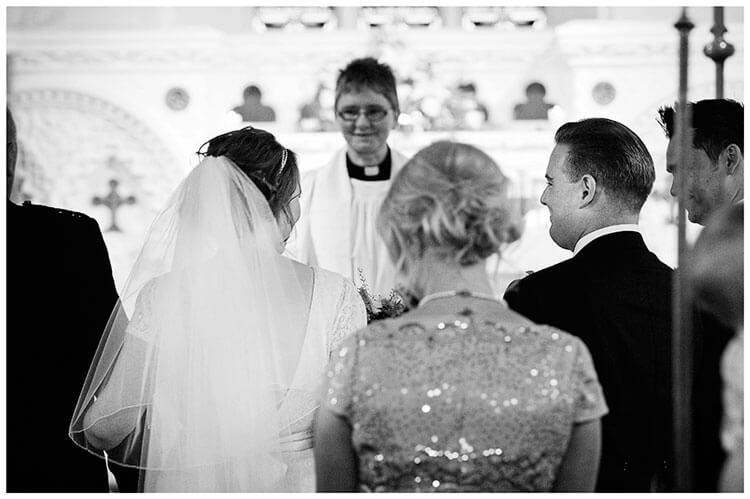 Hartford Church Wedding groom smiles at bride as she arrives at alter