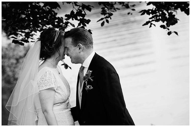 bride groom laughing near water
