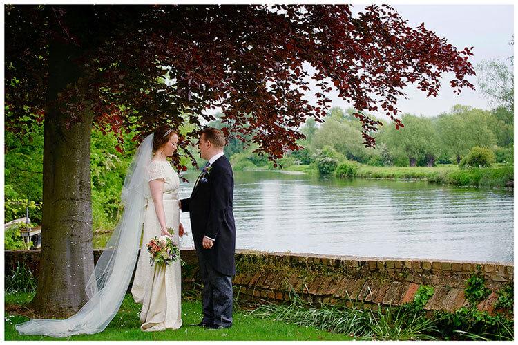 Hartford Church Wedding bride groom share a moment standing near river