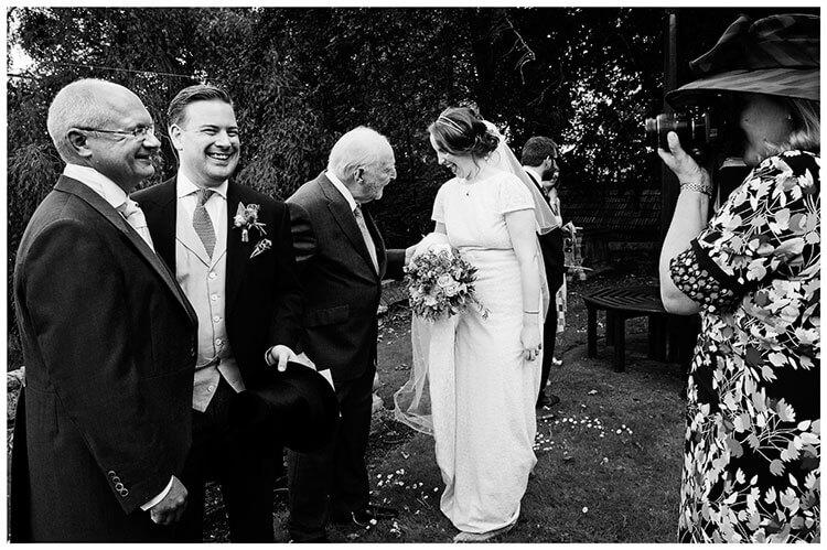 Hartford Church Wedding groom posing for camera bride laughing