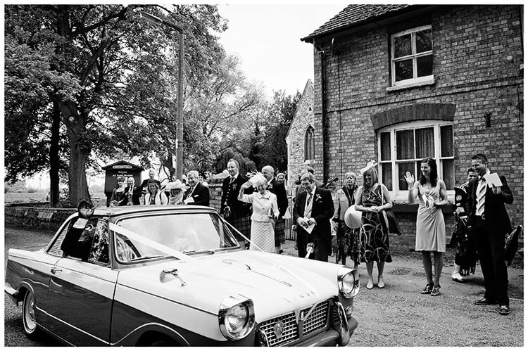 Hartford Church Wedding guests wave bride groom off