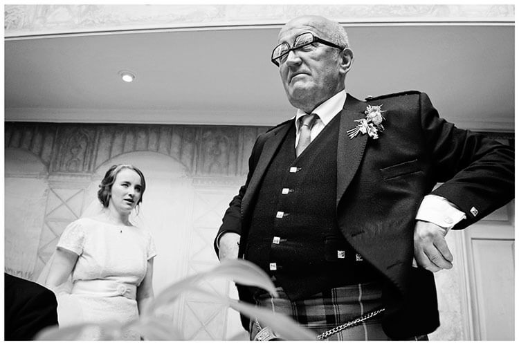 Old Bridge Hotel Wedding man with glasses on upside down bride giving him a look