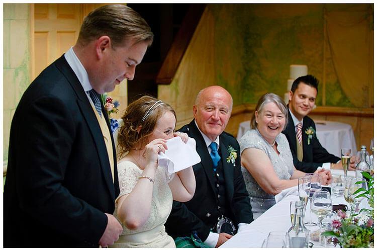 Old Bridge Hotel Wedding bride hides behind napkin during grooms speech