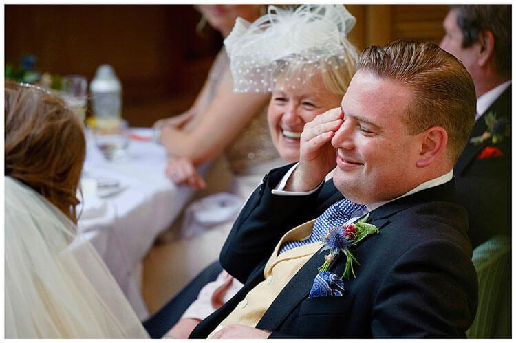 Old Bridge Hotel Wedding groom wipes away tear during best mans speech