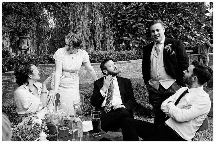 Old Bridge Hotel Wedding bride groom talking to sitting guests