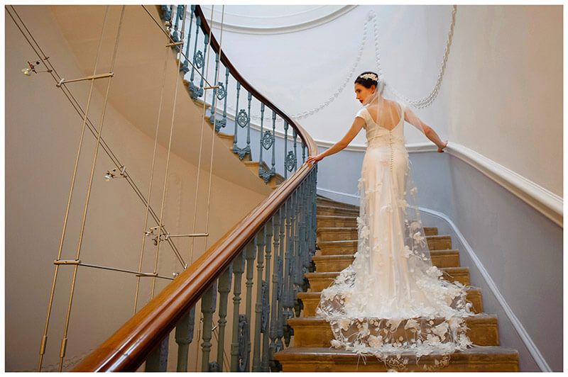 home house wedding photographer bride on grand staircase