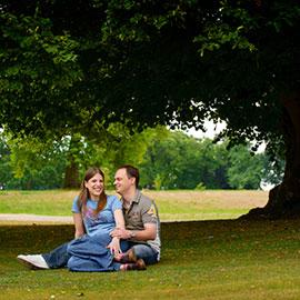 spains hall pre wedding shoot martin kristen sitting on ground under large tree