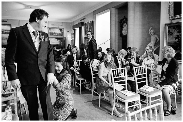 Anglesey Abbey wedding last minute adjustments to grooms suit