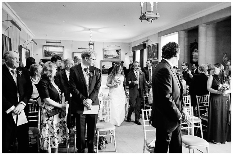 Anglesey Abbey wedding bride walking down aisle on fathers arm