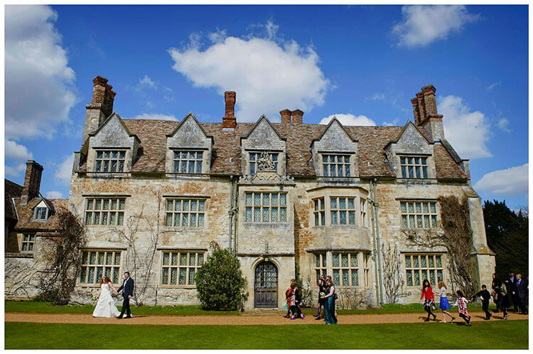 Anglesey Abbey wedding venue bride groom guests