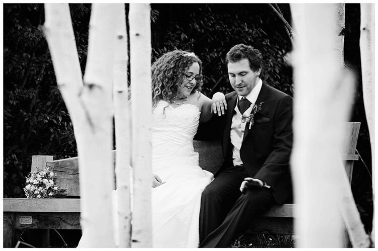 Anglesey Abbey wedding bride groom checking out wedding band,silver birch trees