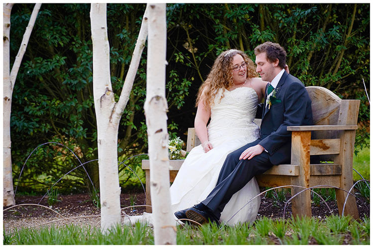 Anglesey Abbey wedding bride groom sitting on bech