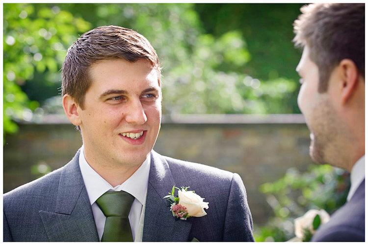 Hemingford Grey wedding groom talking to bestman