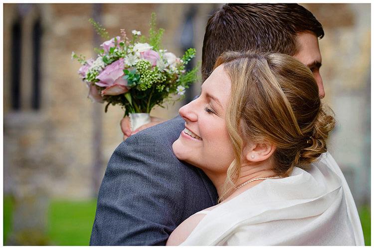 Hemingford Grey wedding brides maid hugs groom