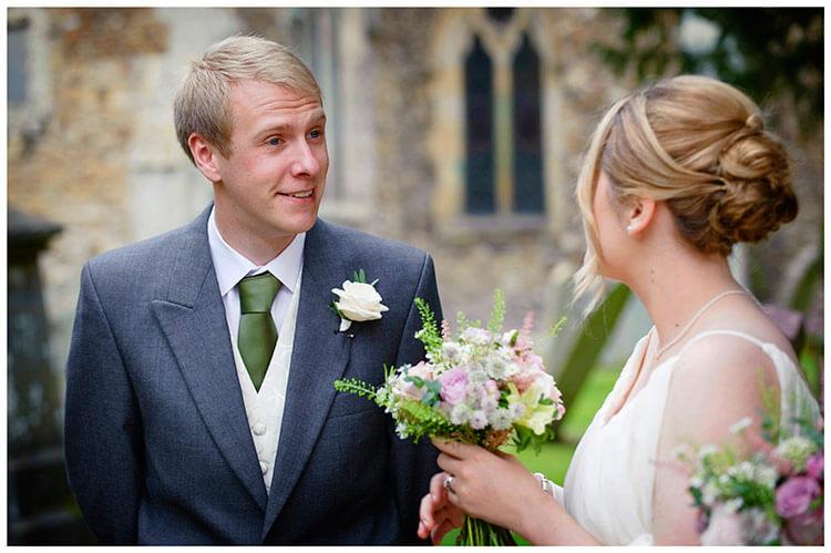 Hemingford Grey wedding usher talking to bridesmaid
