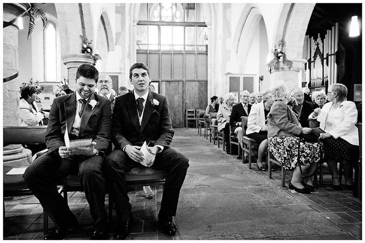 Hemingford Grey wedding groom looking to the skies in church