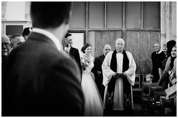 Hemingford Grey wedding grooms first look as bride walks down aisle