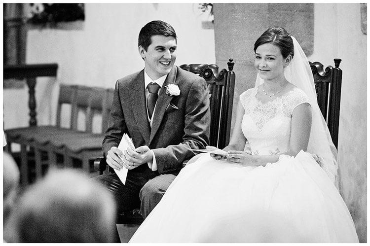 Hemingford Grey wedding smiling groom looking at bride in church