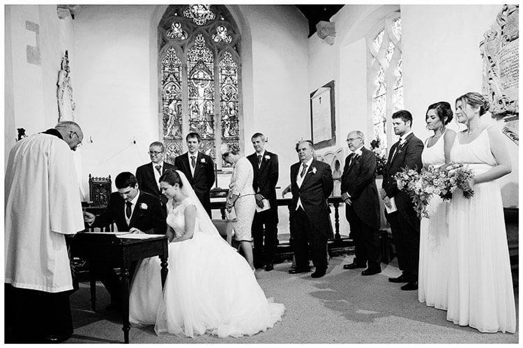 Hemingford Grey wedding signing the register