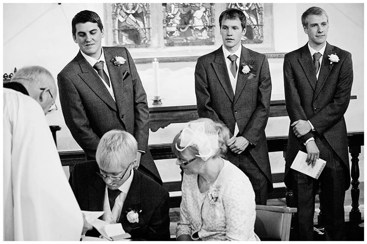 Hemingford Grey wedding groom checking what witness is signing