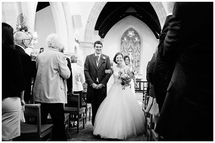 Hemingford Grey wedding bride groom walking down aisle